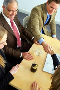 Business people hand shake