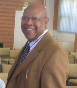 Dr Andre Karamaga