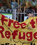 Boy with Free Refugees banner