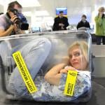 human trafficking; woman in suitcase